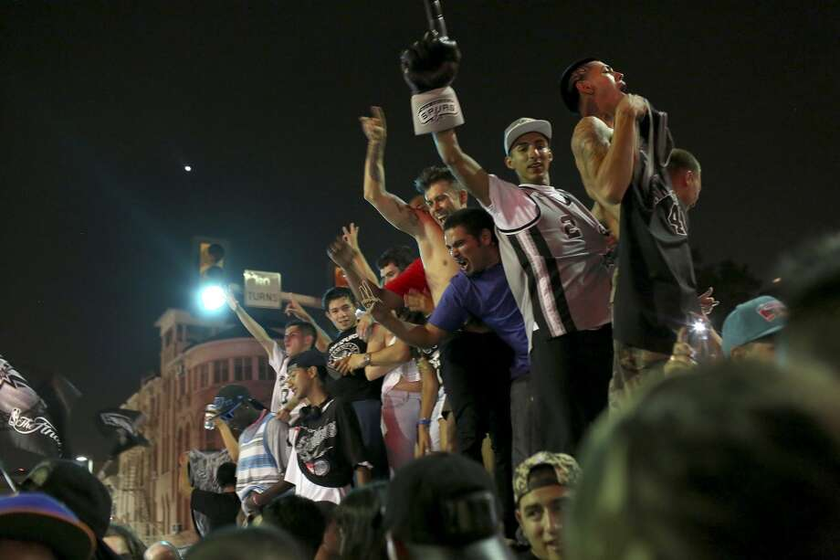 as fans celebrate the Spurs winning the NBA Championship after beating the Miami Heat in downtown San Antonio on Sunday, June 15, 2014. Photo: SAN ANTONIO EXPRESS-NEWS