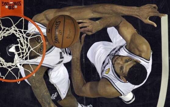 San Antonio Spurs' Kawhi Leonard and Tim Duncan wait for a rebound in Game 5 of the 2014 NBA Finals against the Miami Heat Sunday June 15, 2014 at the AT&T Center. The Spurs won 104-87. Photo: San Antonio Express-News