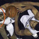 San Antonio Spurs' Kawhi Leonard and Tim Duncan wait for a rebound in Game 5 of the 2014 NBA Finals against the Miami Heat Sunday June 15, 2014 at the AT&T Center. The Spurs won 104-87.