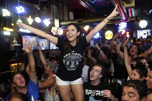 Melissa Riojas celebrates the Spurs winning the NBA Championship after beating the Miami Heat at Ticket Sports Pub in downtown San Antonio on Sunday, June 15, 2014. Photo: SAN ANTONIO EXPRESS-NEWS
