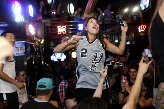 Victoria Ritchie celebrates the Spurs winning the NBA Championship after beating the Miami Heat in downtown San Antonio on Sunday, June 15, 2014. Photo: SAN ANTONIO EXPRESS-NEWS