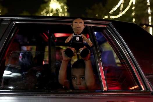 Davian Aguilar, 4, celebrates the Spurs winning the NBA Championship after beating the Miami Heat in downtown San Antonio on Sunday, June 15, 2014. Photo: SAN ANTONIO EXPRESS-NEWS