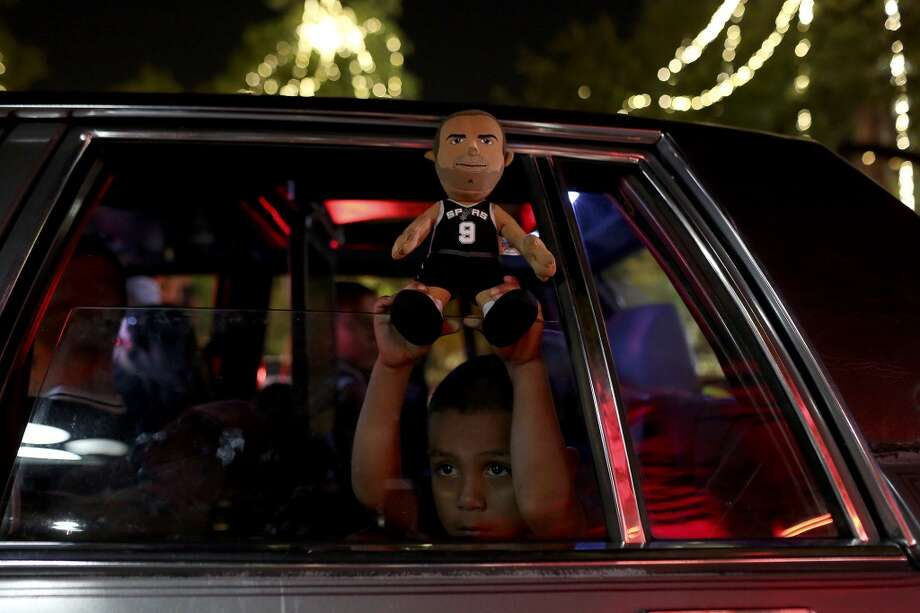 Davian Aguilar, 4, celebrates the Spurs winning the NBA Championship after beating the Miami Heat in downtown San Antonio on Sunday, June 15, 2014. Photo: SAN ANTONIO EXPRESS-NEWS