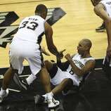 San Antonio Spurs' Patty Mills celebrates after drawing a foul against the Miami Heat during the first quarter of game five of the NBA Finals at the AT&T Center, Sunday, June 15, 2014.
