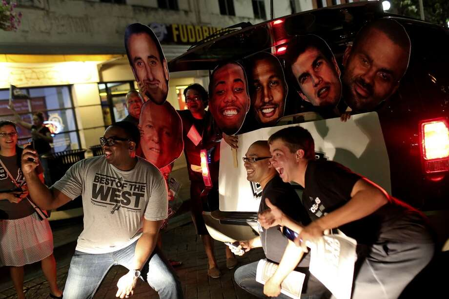 Fans celebrate the Spurs winning the NBA Championship after beating the Miami Heat in downtown San Antonio on Sunday, June 15, 2014. Photo: SAN ANTONIO EXPRESS-NEWS