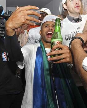 San Antonio Spurs' Patty Mills celebrates in the team's lockeroom after winning the NBA Championship against the Miami Heat at the AT&T Center, Sunday, June 15, 2014. Photo: San Antonio Express-News
