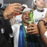 San Antonio Spurs' Patty Mills celebrates in the team's lockeroom after winning the NBA Championship against the Miami Heat at the AT&T Center, Sunday, June 15, 2014.