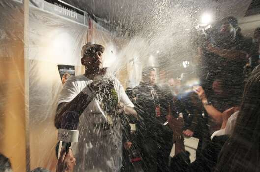 San Antonio Spurs' Boris Diaw sprays the media with champagne while celebrating their NBA Championship title at the AT&T Center, Sunday, June 15, 2014. The Spurs defeated the Miami Heat 4-1 games. Photo: San Antonio Express-News