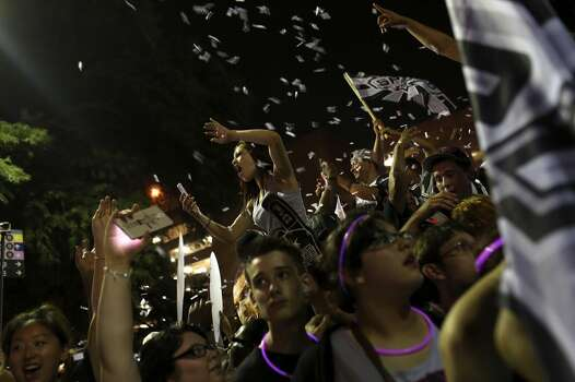 Fans celebrate the Spurs winning the NBA Championship after beating the Miami Heat on Commerce Street in downtown San Antonio on Sunday, June 15, 2014 Photo: SAN ANTONIO EXPRESS-NEWS