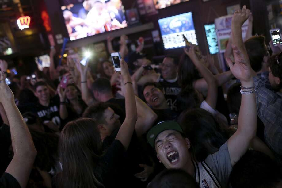Fans celebrate the Spurs winning the NBA Championship after beating the Miami Heat at Ticket Sports Club in downtown San Antonio on Sunday, June 15, 2014. Photo: SAN ANTONIO EXPRESS-NEWS