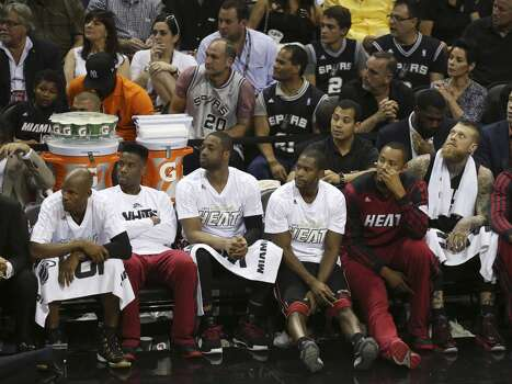The Miami Heat bench sits in silence as the Spurs pull out a commanding lead during the third quarter of game five of the NBA Finals at the AT&T Center, Sunday, June 15, 2014. Photo: San Antonio Express-News