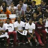 The Miami Heat bench sits in silence as the Spurs pull out a commanding lead during the third quarter of game five of the NBA Finals at the AT&T Center, Sunday, June 15, 2014.
