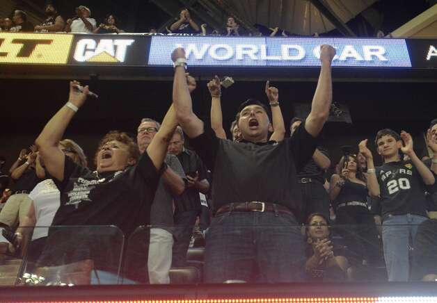 Spurs fans cheer on their team during game 5 of the NBA Finals in the AT&T Center on Sunday, June 15, 2014. Photo: San Antonio Express-News