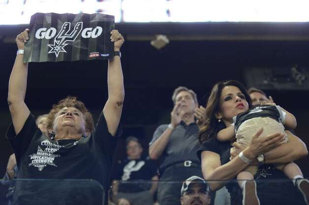 Fans watch as the San Antonio Spurs take on the Miami Heat in game 5 of the NBA Finals in the AT&T Center on Sunday, June 15, 2014. Photo: San Antonio Express-News