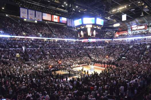 Singer Colbie Caillat sings the national anthem as fans and the Spurs and Heat teams pay respect during game 5 of the NBA Finals in the AT&T Center on Sunday, June 15, 2014. Photo: San Antonio Express-News
