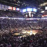 Singer Colbie Caillat sings the national anthem as fans and the Spurs and Heat teams pay respect during game 5 of the NBA Finals in the AT&T Center on Sunday, June 15, 2014.