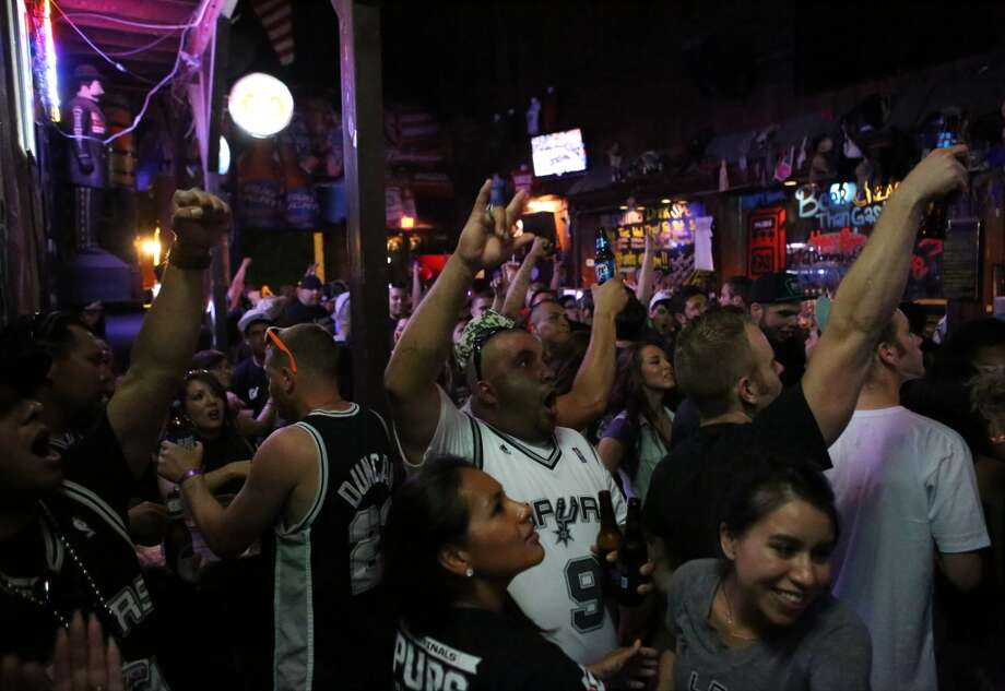 Spurs fans cheer while watching Game 5 of the NBA Finals on Sunday, June 15, 2014, at Coyote Ugly Saloon in San Antonio. Photo: San Antonio Express-News