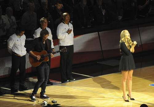 Singer Colbie Caillat sings the Star Spangled Banner before game 5 of the NBA Finals in the AT&T Center on Sunday, June 15, 2014. Photo: San Antonio Express-News