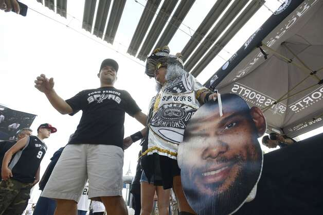 Spurs fan arrive for game 5 of the NBA Finals in the AT&T Center on Sunday, June 15, 2014. Photo: San Antonio Express-News
