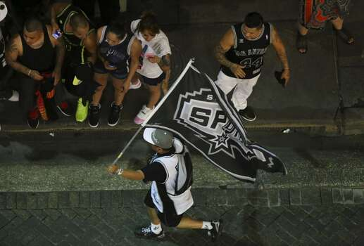 Fans celebrate on W. Commerce Street between N. Presa Street and S. Alamo Street on Sunday, June 15, 2014, after the Spurs won the NBA Championship. Photo: San Antonio Express-News