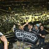 Friends Wade Lewis, left, Dominic Mendiola, Efrain Torres Jr. and Joshua Medina have their picture made after the San Antonio Spurs fans defeated the Miami Heat in the NBA Finals in the AT&T Center on Sunday, June 15, 2014.
