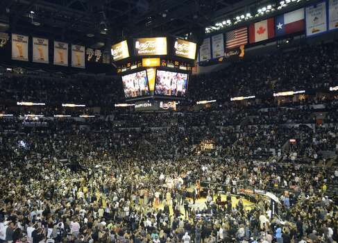 The AT&T Center floor erupts in chaos after the San Antonio Spurs beat the Miami Heat in the NBA Finals on Sunday, June 15, 2014. Photo: San Antonio Express-News