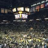 The AT&T Center floor erupts in chaos after the San Antonio Spurs beat the Miami Heat in the NBA Finals on Sunday, June 15, 2014.