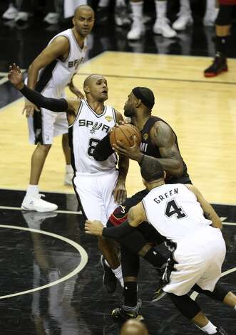 San Antonio Spurs' Patty Mills gets pushed aside by Miami Heat's LeBron James driving to the basket during the send half of game five of the NBA Finals at the AT&T Center, Sunday, June 15, 2014. Photo: San Antonio Express-News