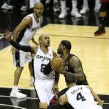 San Antonio Spurs' Patty Mills gets pushed aside by Miami Heat's LeBron James driving to the basket during the send half of game five of the NBA Finals at the AT&T Center, Sunday, June 15, 2014.