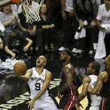 San Antonio Spurs' Tony Parker goes for the layup past Miami Heat's LeBron James during the first quarter of game five of the NBA Finals at the AT&T Center, Sunday, June 15, 2014.
