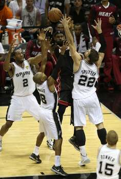 Miami Heat's LeBron James is surrounded by the Spurs defense during the first quarter of game five of the NBA Finals at the AT&T Center, Sunday, June 15, 2014. Photo: San Antonio Express-News