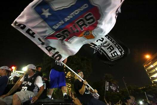 Fans celebrate in downtown San Antonio on Sunday, June 15, 2014, after the Spurs defeated the Miami Heat to win the NBA Championship. Photo: San Antonio Express-News