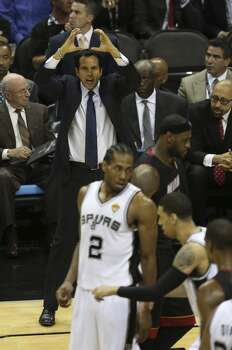Miami Heat head coach Erik Spoelstra tries to get his team under control as the Spurs rally during the second quarter of game five of the NBA Finals at the AT&T Center, Sunday, June 15, 2014. Photo: San Antonio Express-News