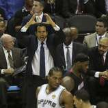 Miami Heat head coach Erik Spoelstra tries to get his team under control as the Spurs rally during the second quarter of game five of the NBA Finals at the AT&T Center, Sunday, June 15, 2014.