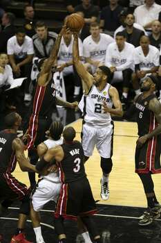 San Antonio Spurs' Tim Duncan takes a shot during the first quarter of game five of the NBA Finals at the AT&T Center, Sunday, June 15, 2014. Photo: San Antonio Express-News