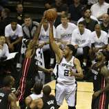 San Antonio Spurs' Tim Duncan takes a shot during the first quarter of game five of the NBA Finals at the AT&T Center, Sunday, June 15, 2014.