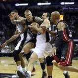 San Antonio Spurs' Manu Ginobili gets fouled by Miami Heat's Chris Andersen during second half action in Game 5 of the 2014 NBA Finals Sunday June 15, 2014 at the AT&T Center.
