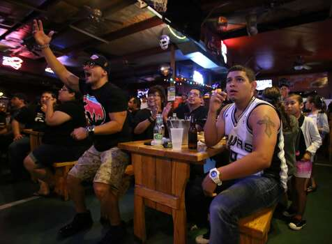 Ruben Hernandez, left, and Luke Villalpando watch Game 5 of the NBA Finals on Sunday, June 15, 2014, at Fatso's Sports Garden in San Antonio. General manager Jim Woods estimated about 500 customers were present to watch the game. Photo: San Antonio Express-News