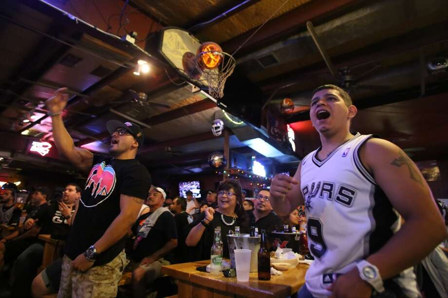 Ruben Hernandez, left, and Luke Villalpando react to a call during Game 5 of the NBA Finals on Sunday, June 15, 2014, at Fatso's Sports Garden in San Antonio. General manager Jim Woods estimated about 500 customers were present to watch the game. Photo: San Antonio Express-News