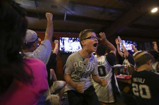 John Arredondo, 12, reacts after a point by the Spurs during Game 5 of the NBA Finals on Sunday, June 15, 2014, at Fatso's Sports Garden in San Antonio. General manager Jim Woods estimated about 500 customers were present to watch the game. Photo: San Antonio Express-News