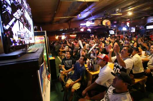 Spurs fans watch Game 5 of the NBA Finals on Sunday, June 15, 2014, at Fatso's Sports Garden in San Antonio. General manager Jim Woods estimated about 500 customers were present to watch the game. Photo: San Antonio Express-News