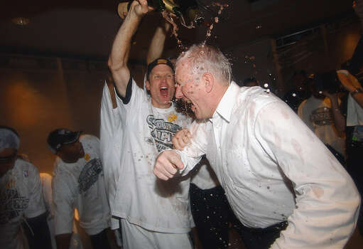 Steve Kerr douses coach Gregg Popovich with champagne during locker room celebration after game 6 of the NBA Finals held Sunday June 15, 2003, at the SBC Center. Photo: EDWARD A. ORNELAS / SAN ANTONIO EXPRESS-NEWS