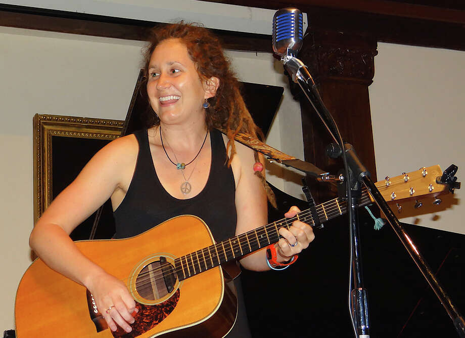 Kristen Graves, a Fairfield musician who is also the state troubadour, performed a Saturday concert to support Operation Hope at the Pequot Library. Photo: Mike Lauterborn / Fairfield Citizen