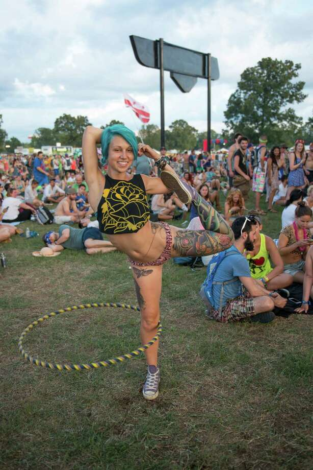 A combination of bad choices:There is no way you can go wrong with a skimpy bikini bottom, half a crop top and a hula hoop. We see no issues here. Nope. Not even the electric blue hair. Photo: Gaelle Beri, Getty / 2014 Gaelle Beri