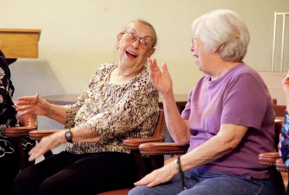 Treemont residents Ann Chaney, left, and Joan Wampler participate in the community's Laughter Yoga class.