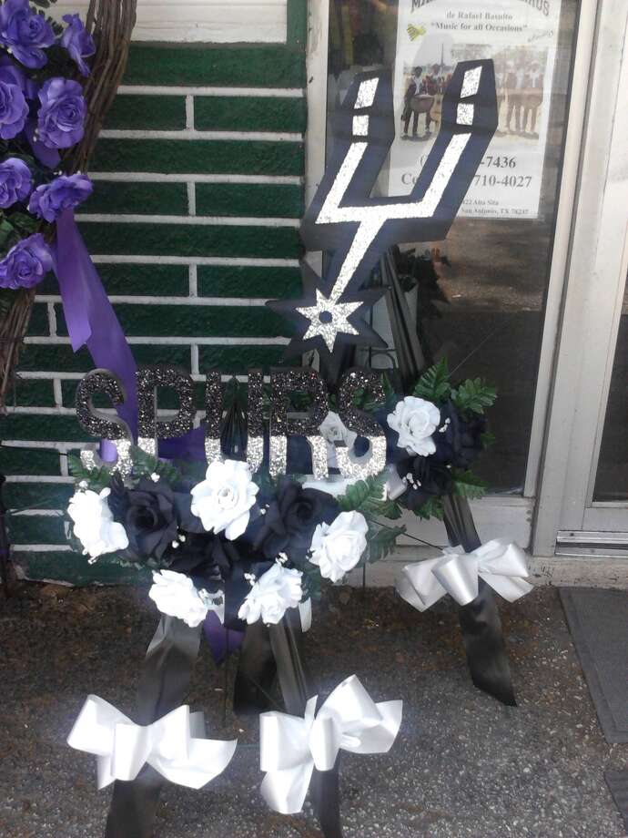 Spurs-themed cemetery decorations made by Diaz Florist. Photo: Courtesy Diaz Florist