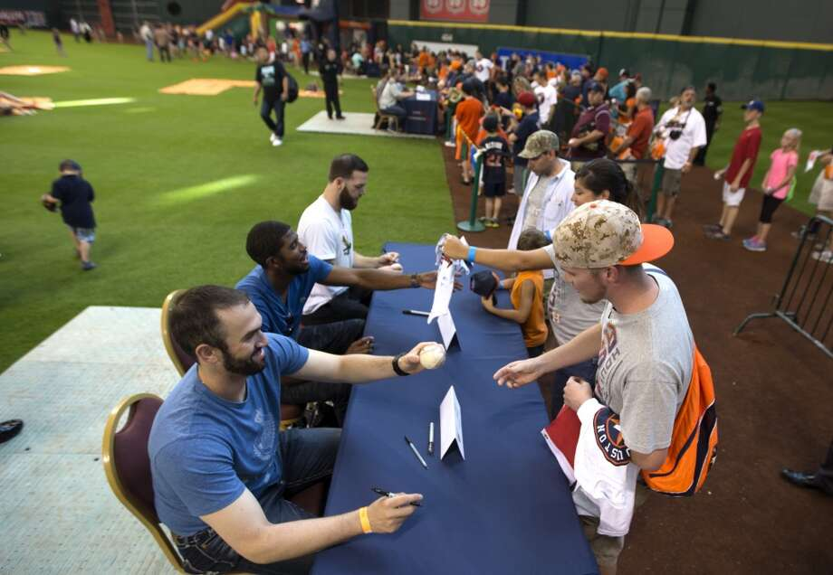 Astros relief pitcher Josh Zeid, left, signs autographs. Photo: Brett Coomer, Houston Chronicle