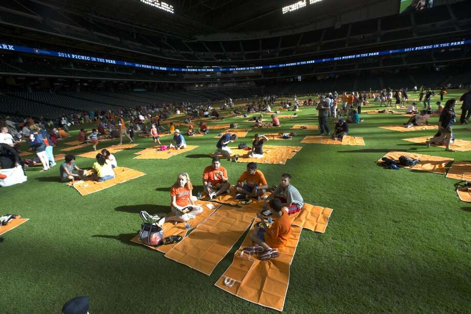 Families scatter through out the outfield. Photo: Brett Coomer, Houston Chronicle