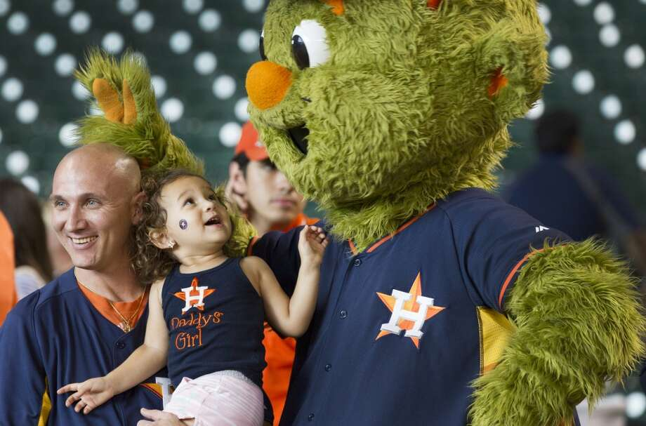 Matt McCurley, left, and his daughter, Madison, pose for a photo with Astros mascot Orbit. Photo: Brett Coomer, Houston Chronicle