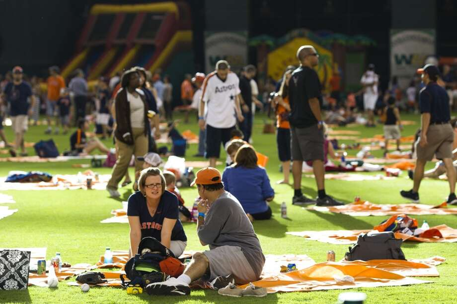Families enjoy picnics in the outfield. Photo: Brett Coomer, Houston Chronicle